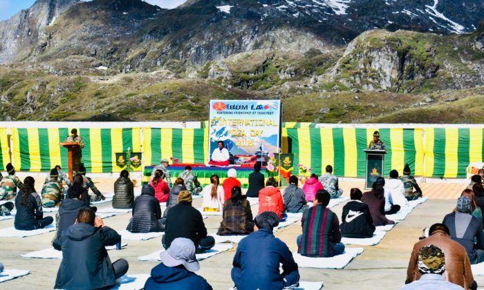 Troops of India and China perform Yoga in Nathu La and Bum La